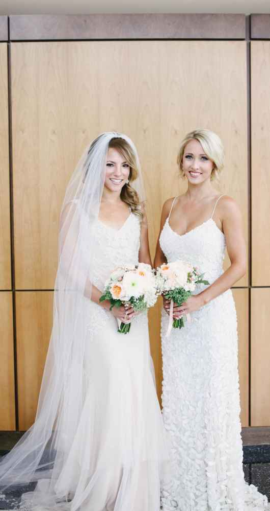 bride and bridesmaid in beautiful gown