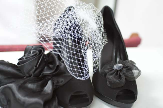 Black Heels With Tulle Bow Next to Birdcage Veil