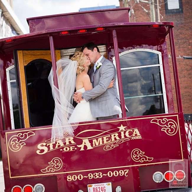 Bride & Groom Share a Kiss on a Trolley