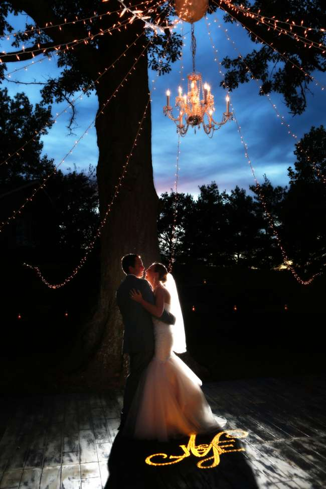 Bride & Groom Dancing Under Outdoor Chandelier