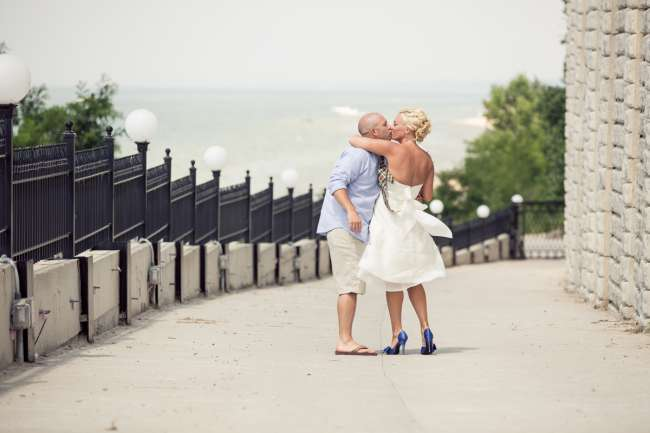 Casual Bride & Groom Kiss in Front of Beach
