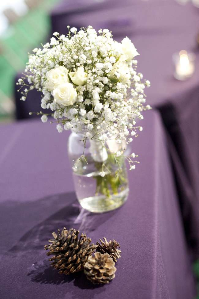 Pinecones Next to White Rose & Baby's Breath Bouquet