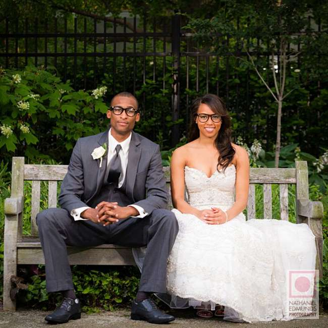 Bride and groom seated on bench