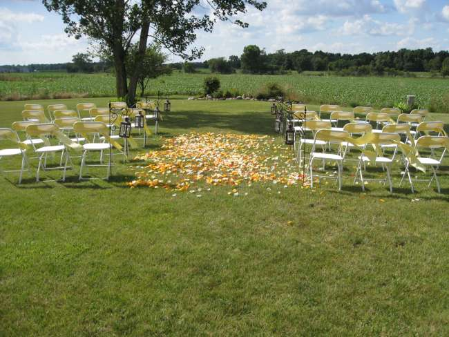 Yellow Petals in Aisle of Outdoor Ceremony