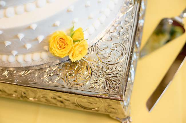 Detail of White Wedding Cake with Yellow Flowers