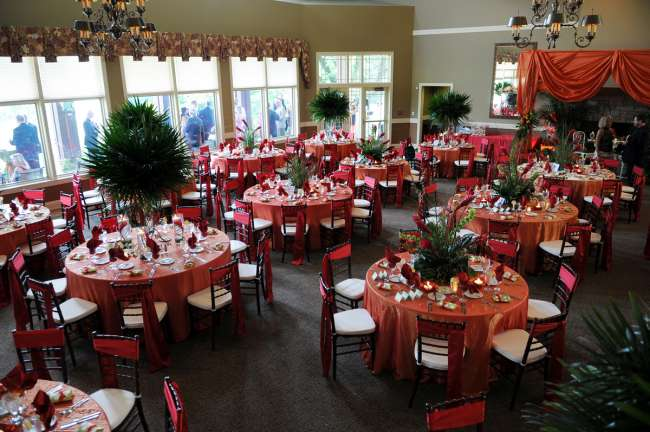 Red  & Orange Reception With Tall Greenery