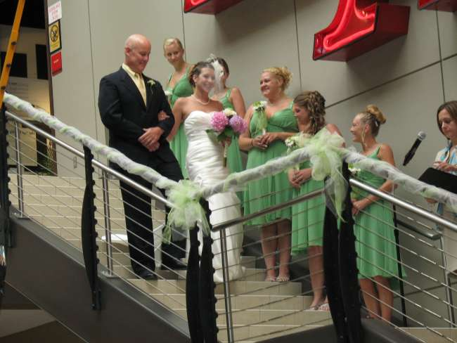 Bride's grand entrance down staircase