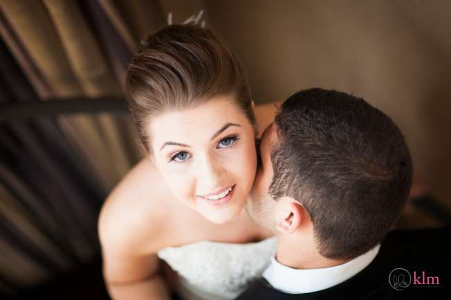 Groom Kissing Bride's Cheek
