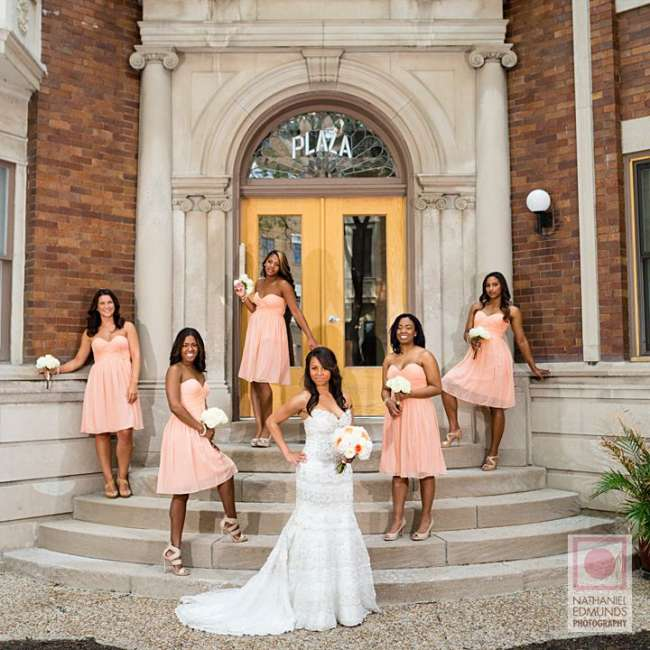 Bride with bridesmaids outside of venue