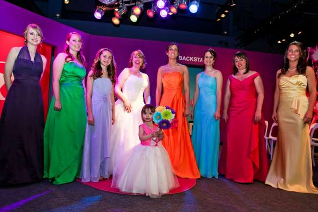 Bridal party featuring different colored dresses