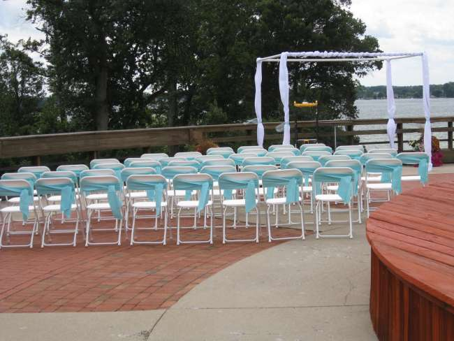Turquoise Chair Covers At Outdoor Ceremony