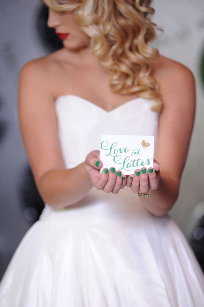 "Bride Holding ""Love and Lattes"" Sign"