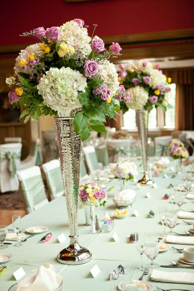 Tall, Floral Centerpieces in Silver Vases
