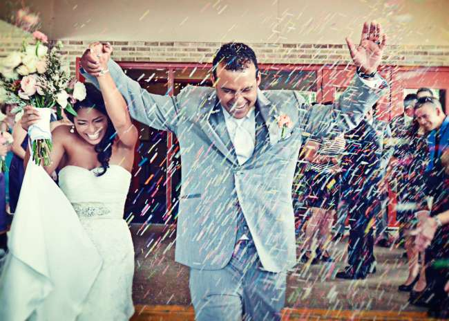 Couple Runs Through Confetti as They Leave the Ceremony