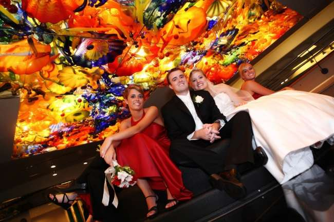 Wedding party poses beneath kaleidoscope ceiling