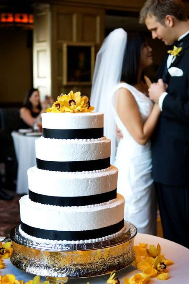 White Cake With Black Trim & Yellow Flowers