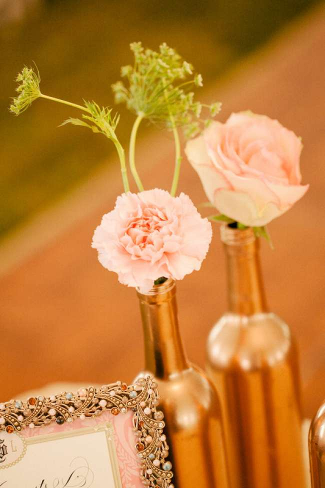 Gold painted wine bottles used as centerpieces