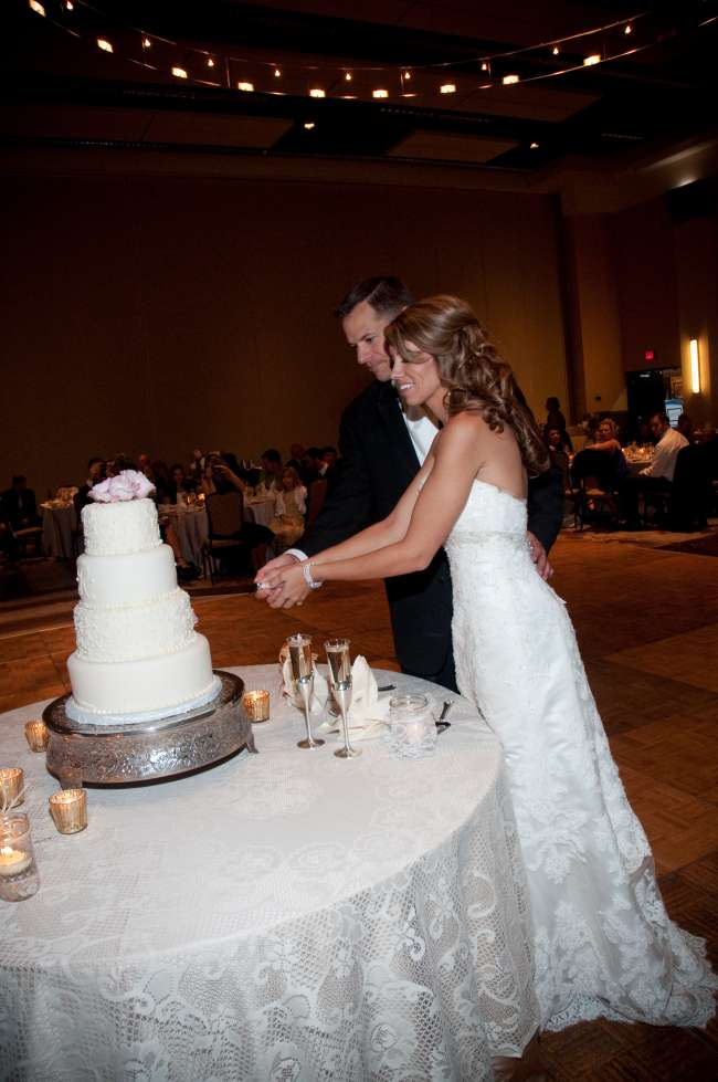 Cake cutting on lace tablecloth