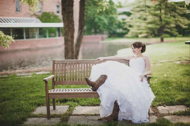 Bride in Essence of Australia Gown & Cowgirl Boots