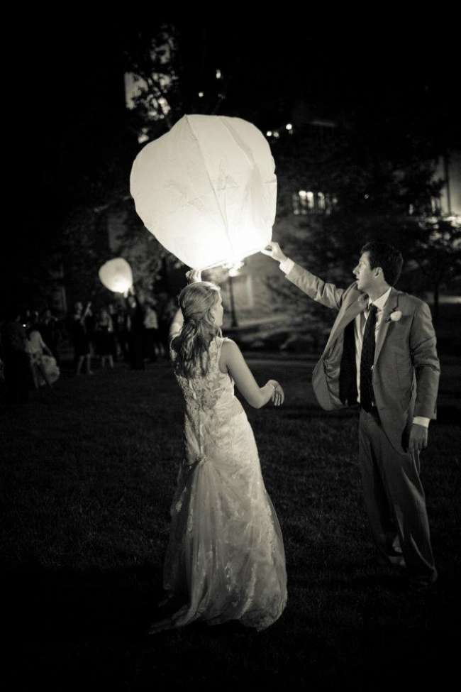 Bride and groom releasing lanterns