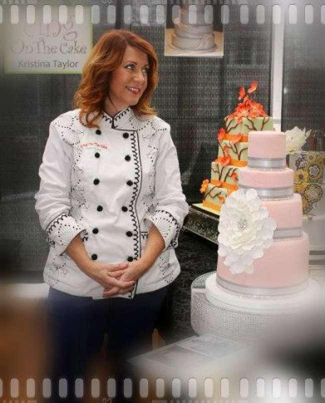 Baker standing next to her wedding cake masterpiece