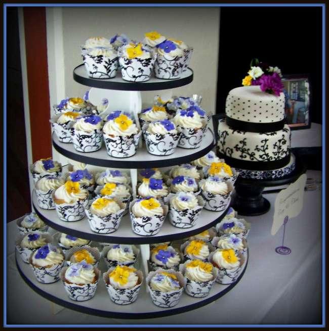 Wedding cake with accompanying cupcake tower