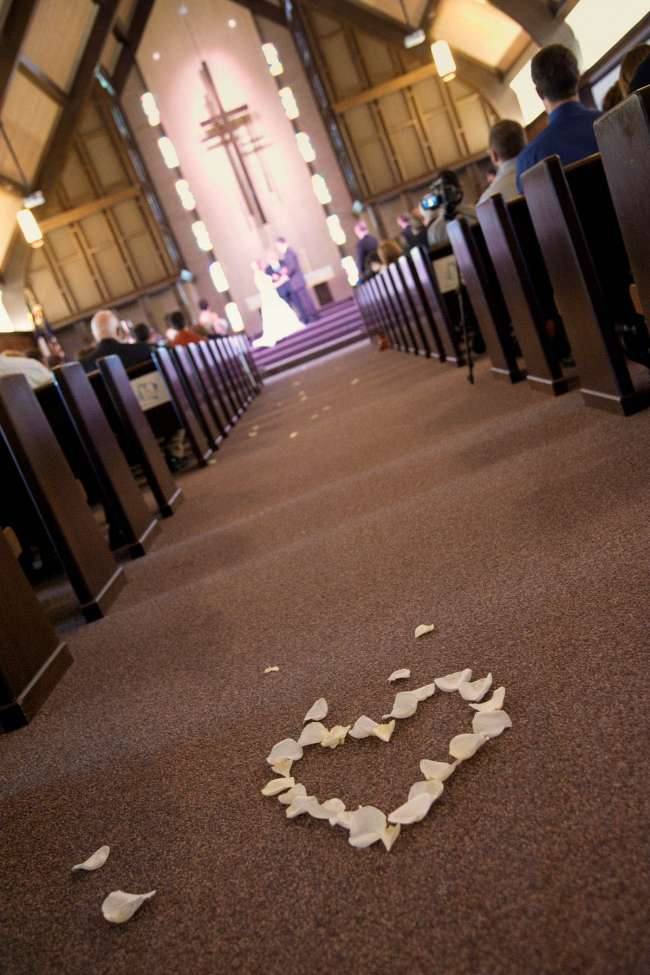 Heart-Shaped White Rose Petals in Aisle