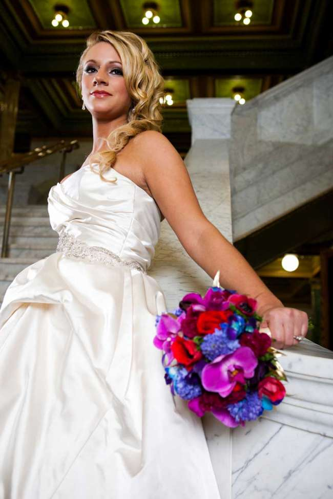 Bride in Strapless Satin Gown Holding a Bouquet