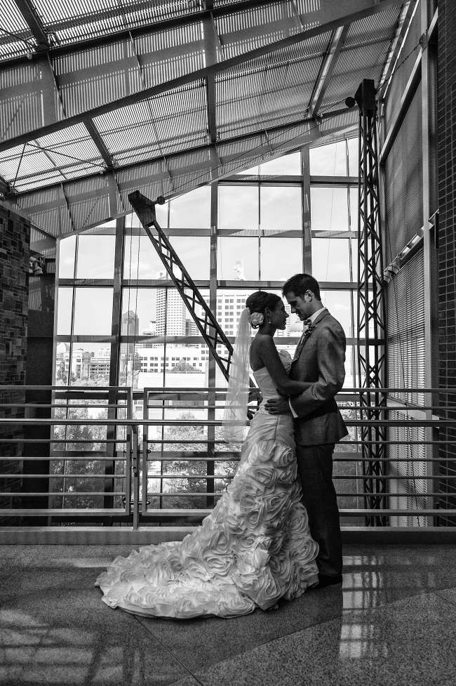 Bride and groom in industrial setting