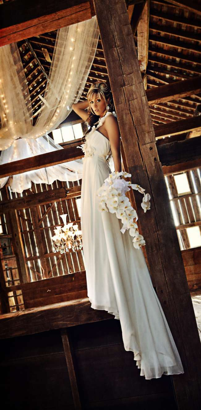 Bride Holding an Orchid Bouquet in Barn