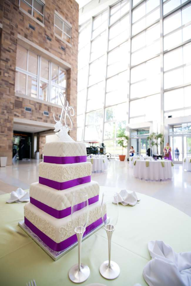 Four tiered wedding cake inside venue