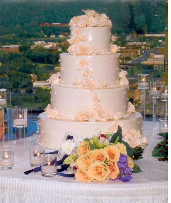 Four tiered wedding cake with flowers