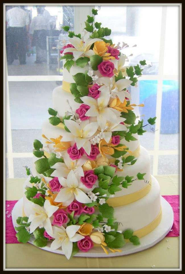 Sugar flowers accenting wedding cake