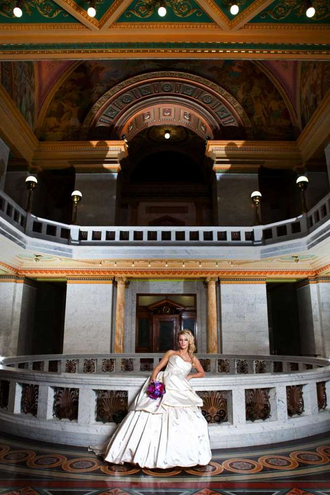 Bride Standing with Purple Bouquet in Courthouse