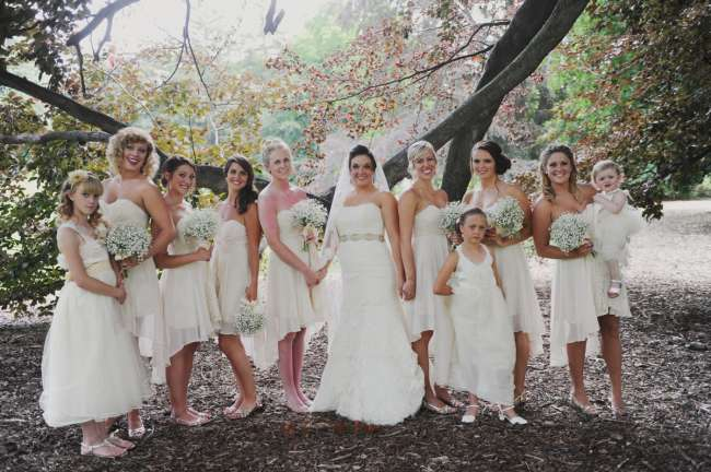Bride With Bridesmaids in High-Low Dresses & Baby's Breath Bouquets