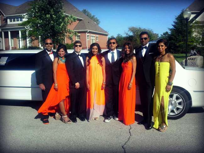 Wedding Party in Front of a Limousine