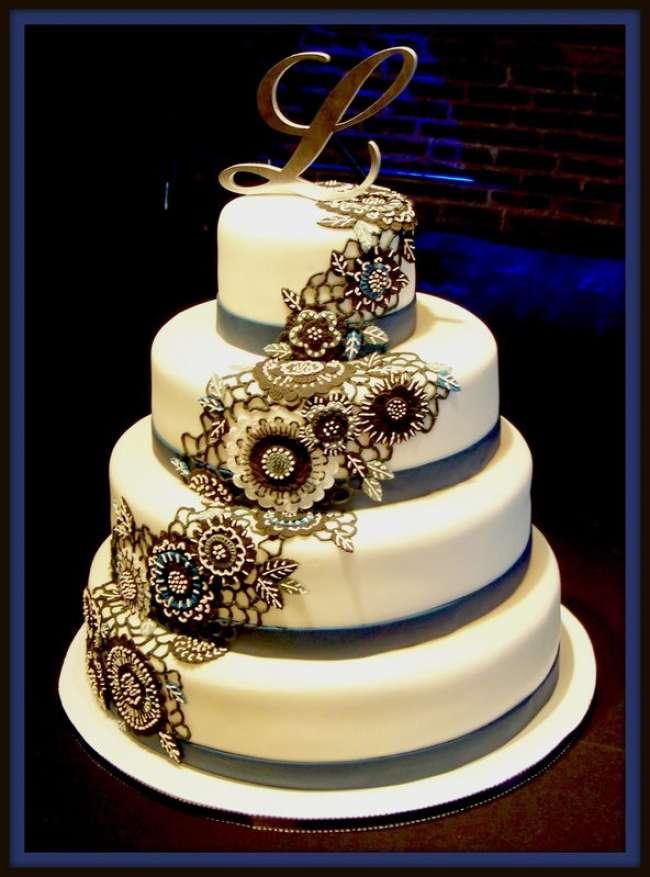 Edible decor incorporated onto wedding cake