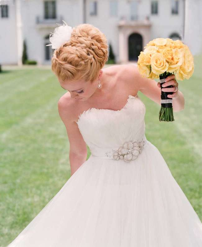 Bride with Updo Holding a Yellow Bouquet