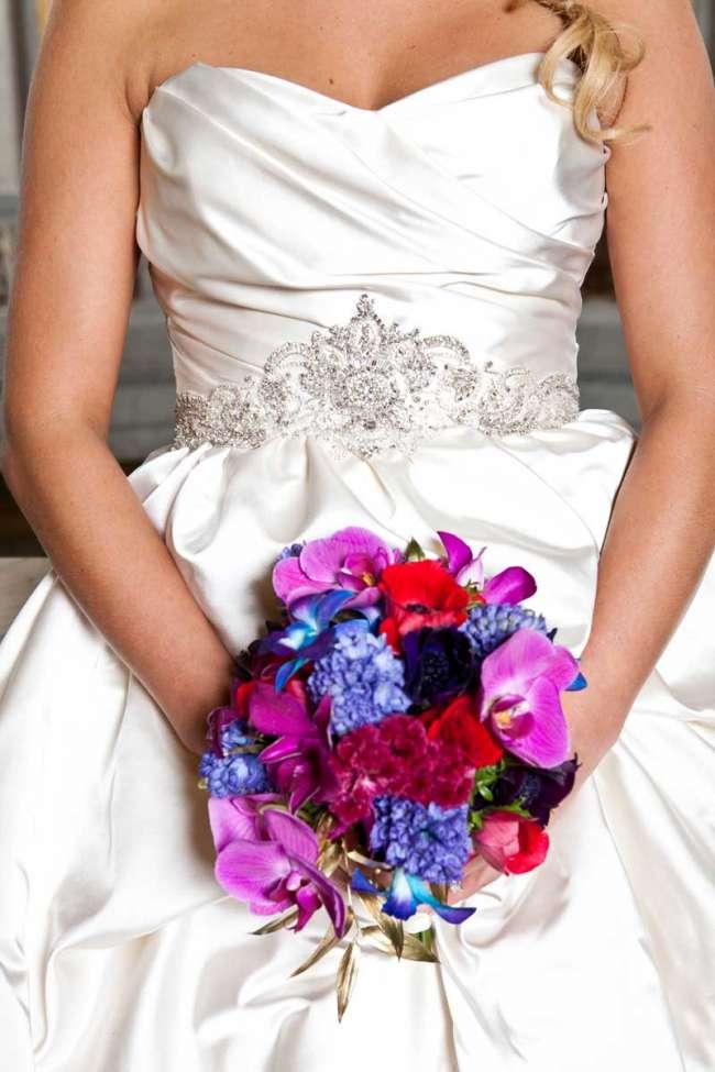 Bride Holding a Purple, Magenta & Blue Bouquet