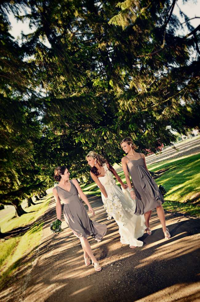 Bride Walking With Two Bridesmaids
