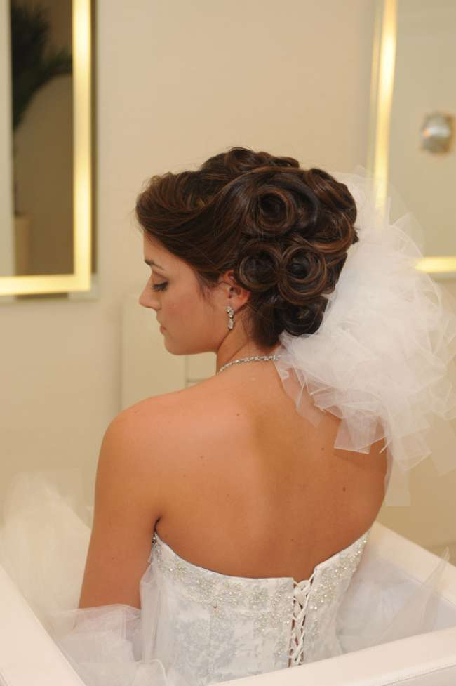 Bride with strapless gown in updo