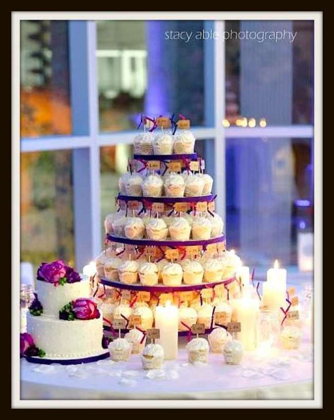Cupcake tower surrounded by candles