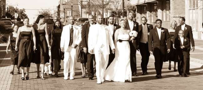 Wedding Party Walks Behind the Bride & Groom