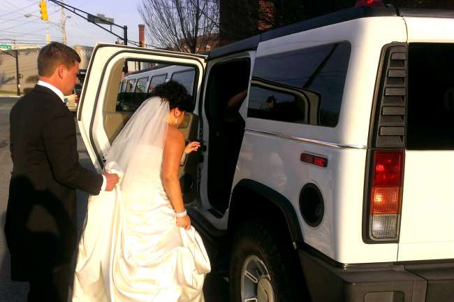 Bride & Groom Getting in Stretch Hummer