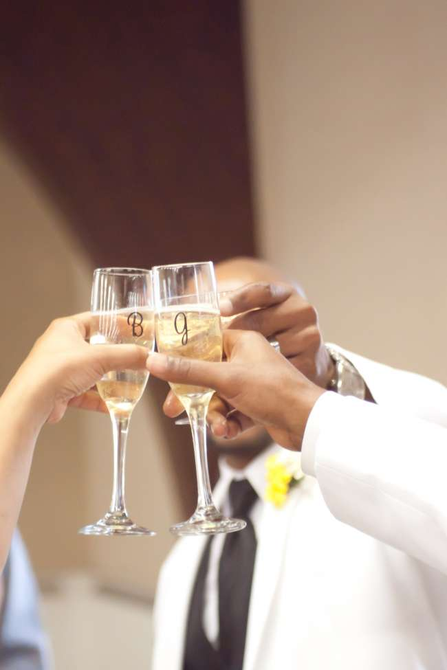 Bride & Groom Toast With Initialed Champagne Glasses