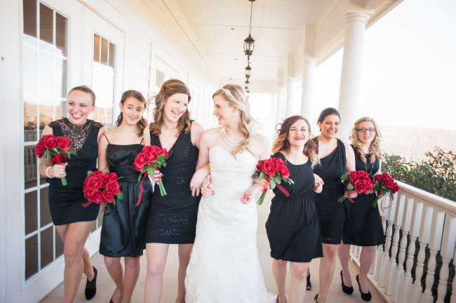 Bridesmaids wear black with a hint of red