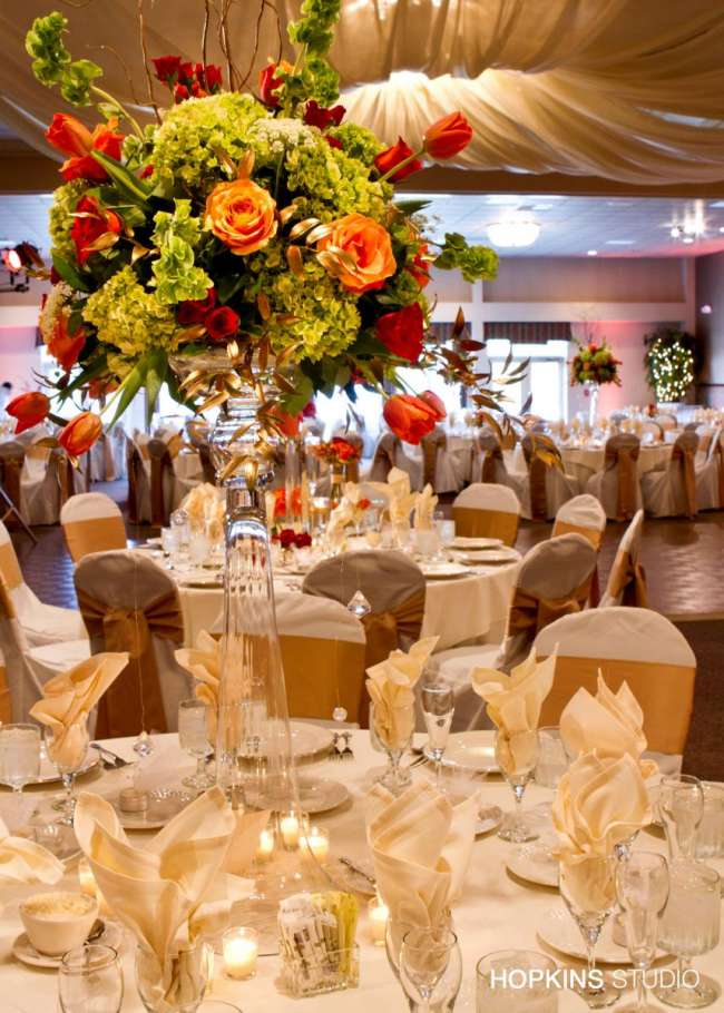 tall centerpieces on ivory linens