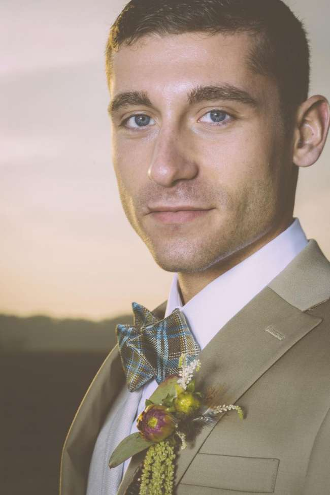 Groom in Plaid Bow Tie with Modern Boutonniere