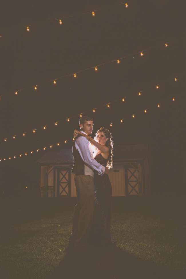 Bride & Groom Dance Under Outdoor Lights