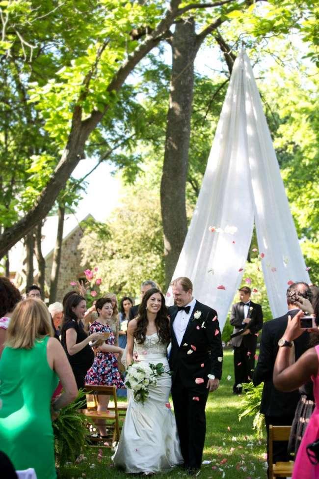Flower Petals Thrown as Bride & Groom Walk Down the Aisle